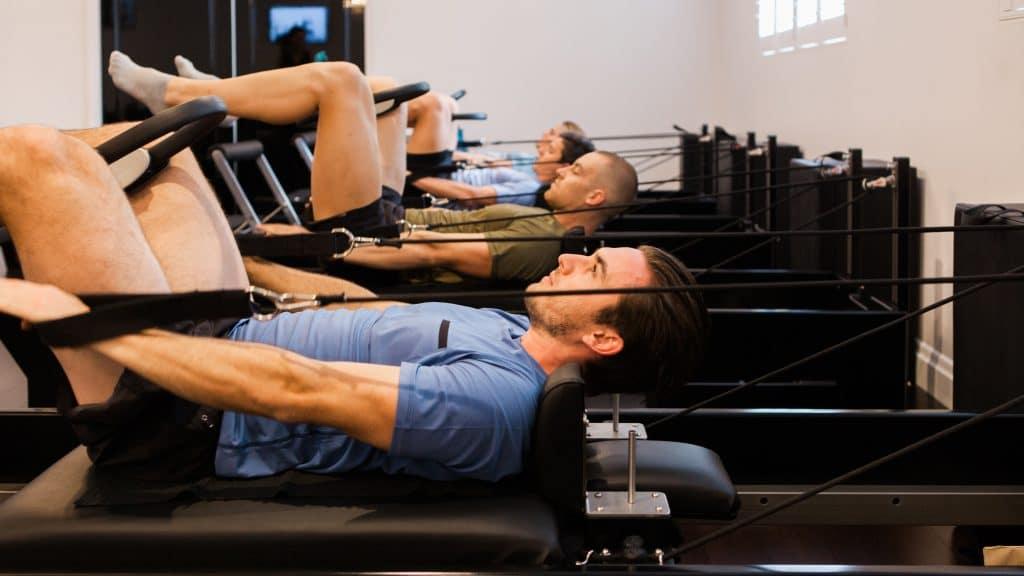 Busting the guys don t do pilates myth studio pilates